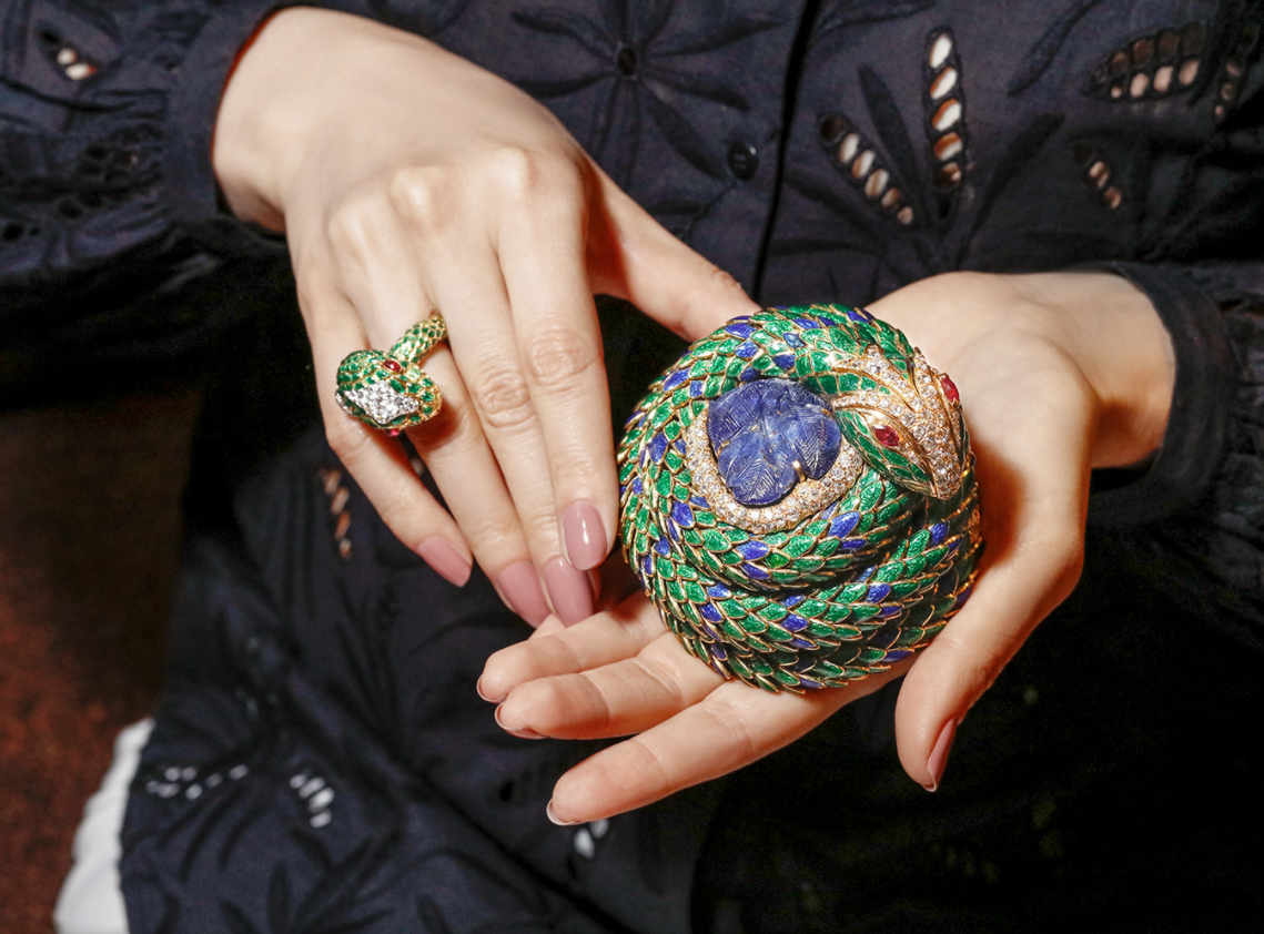David Webb 'Snake' ring with cabochon rubies, brilliant cut diamonds and green enamel in 18k gold and platinum, and 'Snake' box with carved sapphire, faceted oval cut rubies, brilliant cut diamonds, and blue and green enamel in 18k gold